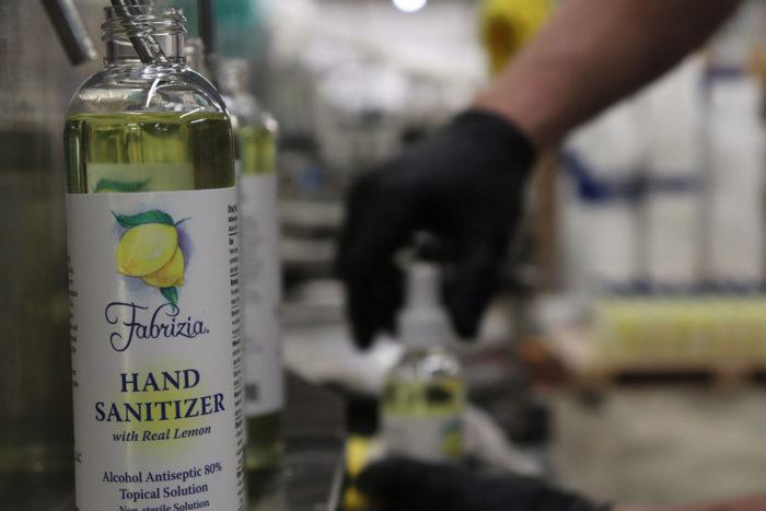 hand sanitizer bottle filling